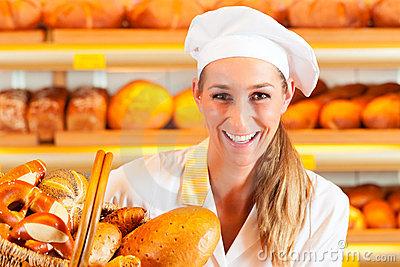 female-baker-bakery-selling-bread-basket-22773093